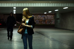 Afraid woman in the subway. Afraid women in the subway at night stock photos