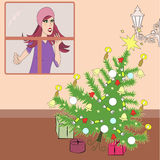 Afraid woman watching a falling Christmas tree Royalty Free Stock Photography