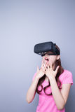 Afraid woman watching virtual reality Royalty Free Stock Photo