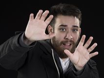 Afraid Young Man with Hands Up Stock Photo