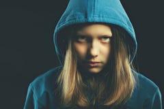 Afraided teen girl in hood. Studio shot Royalty Free Stock Photo