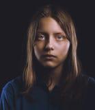 Afraided teenage girl Stock Images