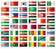 africa asia flags den glansiga seten Arkivfoton