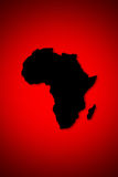 Africa background. Africa in black with red background Royalty Free Stock Photo
