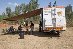 Africa bicycle race expedition. The truck of the Africa bicycle race expedition 2013 on the Ethiopia road in February to support the iron man of the race. The Stock Photography