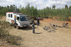 Africa bicycle race expedition. The truck of the Africa bicycle race expedition 2013 on the Ethiopia road in February to support the iron man of the race. The Stock Images