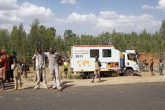 Africa bicycle race expedition. The truck of the Africa bicycle race expedition 2013 on the Ethiopia road in February to support the iron man of the race. The royalty free stock photography