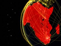 Africa on dark Earth with network representing telecommunications, internet or intercontinental air traffic. 3D illustration. Elements of this image furnished stock illustration