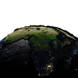 Africa on Earth at night with exaggerated mountains. Africa on model of Earth with exaggerated surface features including ocean floor at night. 3D illustration Royalty Free Stock Photography