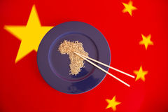 Africa eat. Exploitation of africa by china. Plate with rice Stock Photography