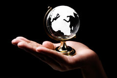 Africa and Europe continent. Single hand holding a glass globe showing Africa and Europe continent Stock Photography