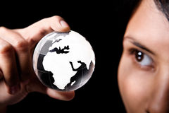 Africa and Europe continent. A woman examining a glass globe which showing Africa and Europe continent Royalty Free Stock Photo