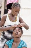 Africa hairstyles. In africa, most of the girls braid their or mat Stock Photo