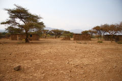 Africa houses in dry land Stock Photography