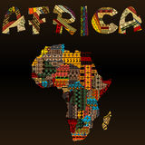 Africa map with African typography made of patchwork fabric text. Ure over black background Royalty Free Stock Photos