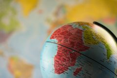 Africa map on a globe with earth map in the background. Africa map on a globe with earth map in the background royalty free stock photos