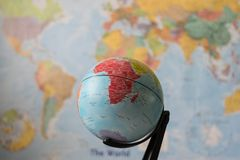 Africa map on a globe. With the whole world as background royalty free stock images