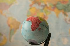Africa map on a globe. With the whole world as background stock photo