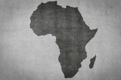Africa map on vintage textured background , continent silhouette. Africa map on vintage textured background - continent silhouette stock illustration