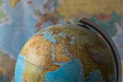 Africa and middle east map on a globe with earth map in the background.  stock photos