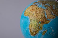 Africa and middle east map on a globe with earth map in the background.  royalty free stock photography