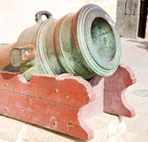 In africa morocco  gre en bronze cannon and the blue sky Royalty Free Stock Images
