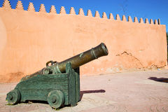 In africa morocco  green bronze cannon and the blue sky Stock Image