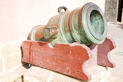 In africa morocco  green bronze cannon and the blue sky Royalty Free Stock Images