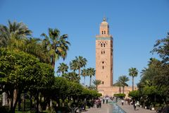 Marrakech,morocco mosque koutoubia in city downtown with tower. In africa morocco, marrakech. with green trees and blue sky. famous landmark of city Stock Photography