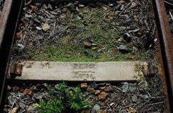 Africa- Old Railroad Tie With the Word ZOMBA Imprinted. This old rusted railroad tie near Knysna, South Africa has the word ZOMBA stamped on it. Some books stock photography