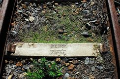 Africa- Old Railroad Tie With the Word ZOMBA Imprinted. This old rusted railroad tie near Knysna, South Africa has the word ZOMBA stamped on it. Some books stock photos
