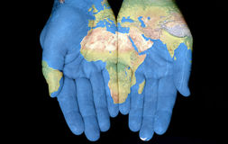 Africa In Our Hands. Map painted on hands showing concept of having the Country Of Africa in our hands royalty free stock photos