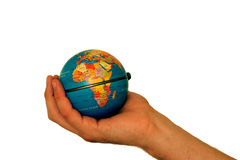 Africa is in our hands. Looking after Africa - it is in our hands. Earth held in a hand over a white background Royalty Free Stock Images