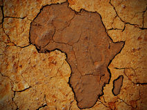 Africa shape on dry soil. The Africa shape on a dry soil texture stock photos