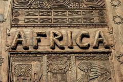 Africa Sign. An africa sign on wood with carvings Stock Image