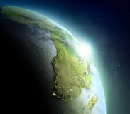 Africa from space during sunrise. Sunrise above Africa. Concept of new beginning, hope, light. 3D illustration with detailed planet surface, atmosphere and city Stock Photography