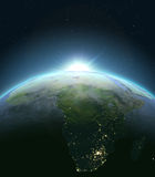 Africa from space during sunrise. Sunrise above Africa. Concept of new beginning, hope, light. 3D illustration with detailed planet surface, atmosphere and city Royalty Free Stock Photography