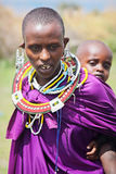 Africa, Tanzania - February 2016: Little baby behind the mother. Masai tribe. Royalty Free Stock Photography