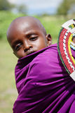 Africa, Tanzania - February 2016: Little baby behind the mother. Masai tribe. Royalty Free Stock Photos