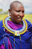 Africa, Tanzania - February 2016: Masai woman of the tribe in a village in traditional dress Royalty Free Stock Image