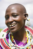 Africa, Tanzania - February 2016: Masai woman of the tribe in a village in traditional dress Stock Images
