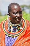 Africa, Tanzania - February 2016: Masai woman of the tribe in a village in traditional dress Royalty Free Stock Photo
