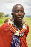 Africa, Tanzania - February 2016:Masai woman of the tribe in a village in traditional dress Royalty Free Stock Photos