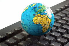 Africa on toy globe over keyboard Royalty Free Stock Photo