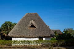 Africa tropical resort. African tropical resort traditional houses. Small bungalow house on beauteful luxury sea beach resort Stock Images