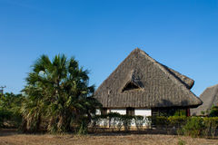 Africa tropical resort. African tropical resort traditional houses. Small bungalow house on beauteful luxury sea beach resort Royalty Free Stock Photos