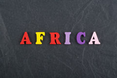 AFRICA word on black board background composed from colorful abc alphabet block wooden letters, copy space for ad text. Learning english concept royalty free stock photos