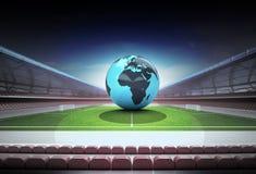 Africa world globe in midfield of magic football stadium Stock Photography