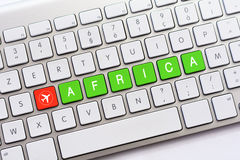 AFRICA writing on white keyboard with a aircraft sketch Stock Images