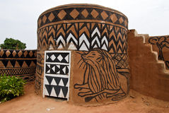 African adobe hut. Adboe hut in Tiebele, Burkina Faso with traditional tribal painting royalty free stock image